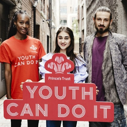 Group holding Prince's Trust sign