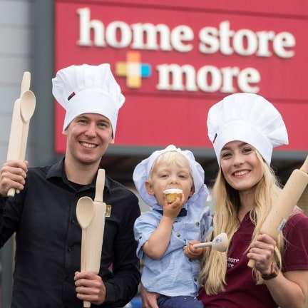 Founders standing in front of Home Store + More store