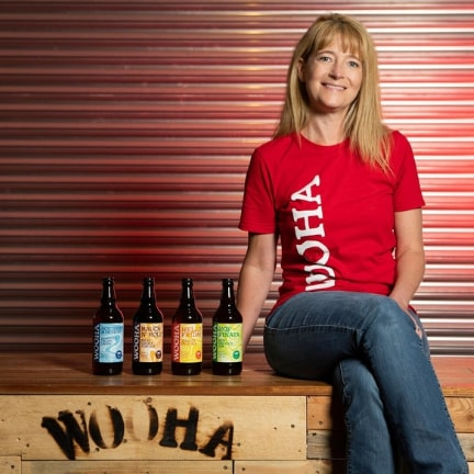 Woman sitting with bottles of Wooha
